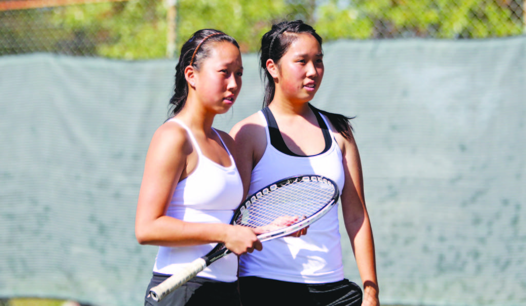 Far from home, Lim sisters connect on the court