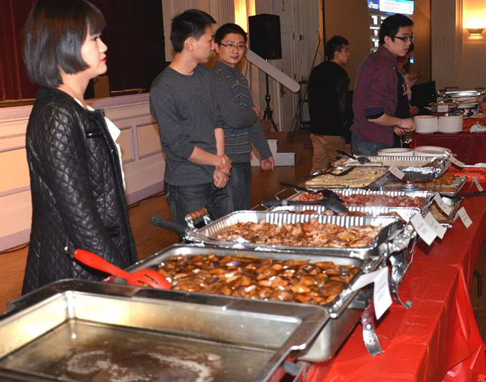 Members of the Chinese Students and Scholar Association serve food at their event last Sunday.