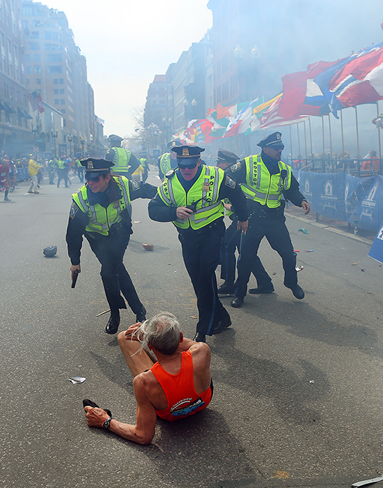 Police react to the second explosion at the finish line of the Boston Marathon. Three people were killed and over 170 were injured in the blasts. Kelvin Smith Library staff member Rich Wisneski was at the bomb site only moments earlier.