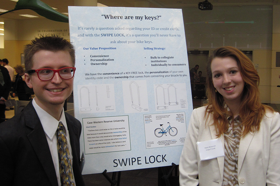 Junior+Joshua+Schwarz+and+sophomore+Marie+Brosovich+present+their+business+proposal+at+the+Blackstone+Launchpad+kick-off+on+Tuesday.+They+are+working+to+create+bike+locks+which+can+be+unlocked+through+scanning+a+card+ID.+