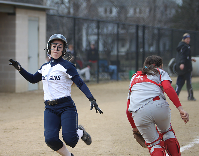 Freshman Rebecca Komar scores one of her two runs against Denison.  Komar went 3-for-8 against the Big Red with an RBI.