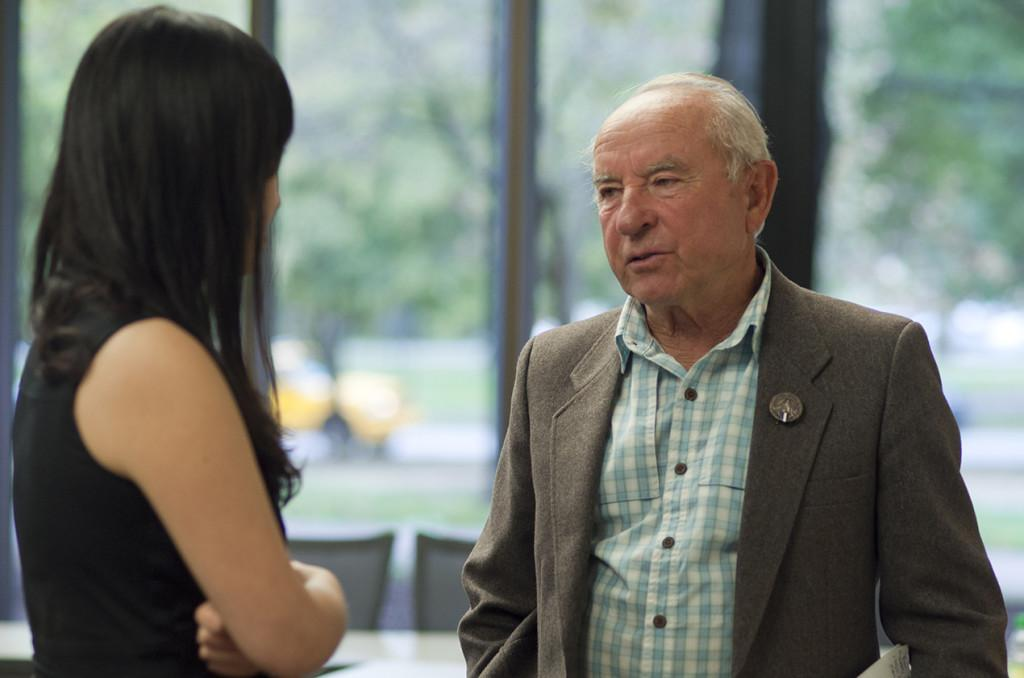 Yvon Chouinard speaks to an attendee of his panel session last Friday. Chouinard is an avid environmentalist and his company, Patagonia, has donated one percent of sales to environmental groups since 1985.