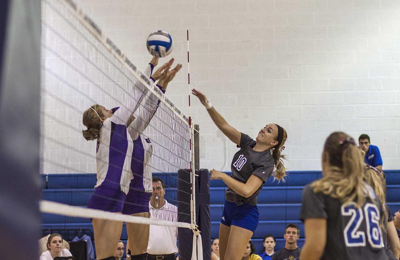 Sophomore Haley Kauffman goes up for a block as teammate Carolyn Bogart looks on during a match versus Capitol on Septermber 7th.