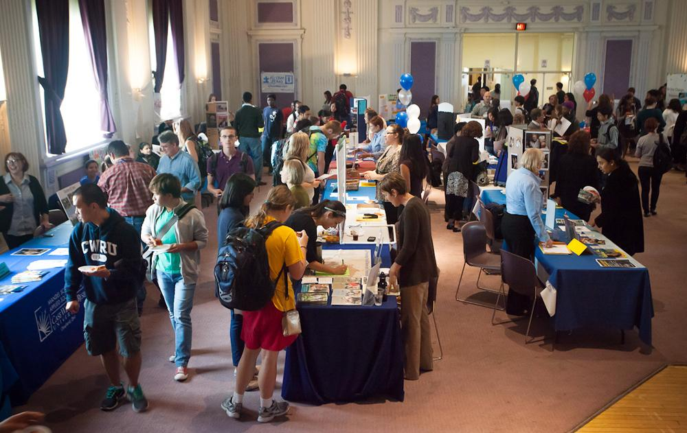 Students at last year's Center for Civic Engagment and Learning's service fair visit booths to learn about volunteer opportunities on campus and the local Cleveland area. The event, which occurs once every semester, will be held next Friday, Sept. 13, in Thwing's ballroom.