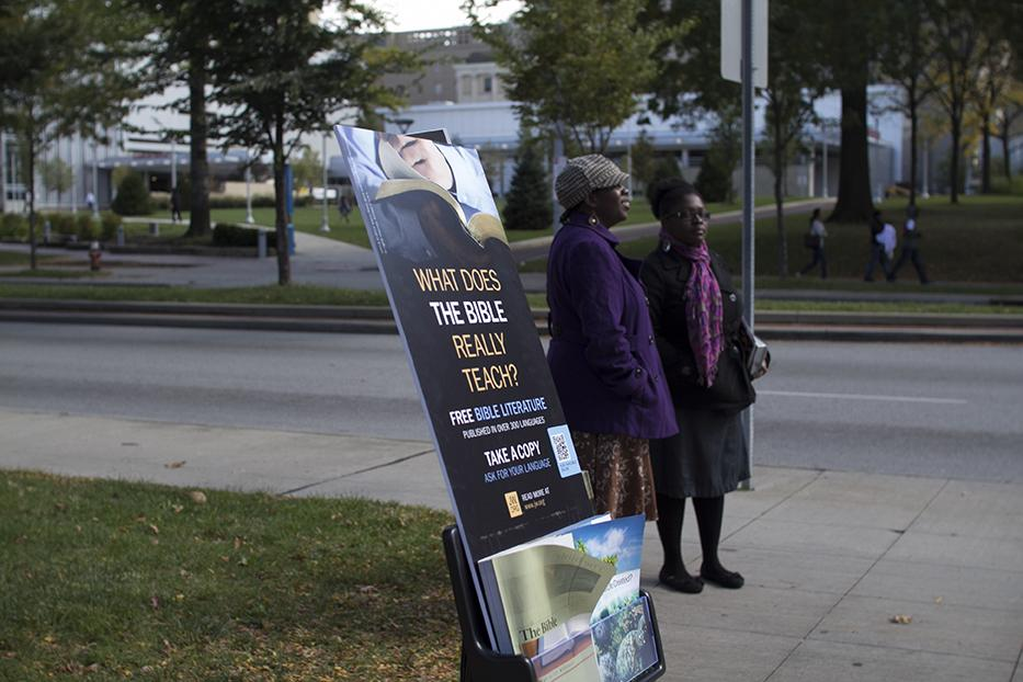 Members of the Jehovah's Witnesses faith hand out Biblical literature near the corner of Aldebert and Euclid.