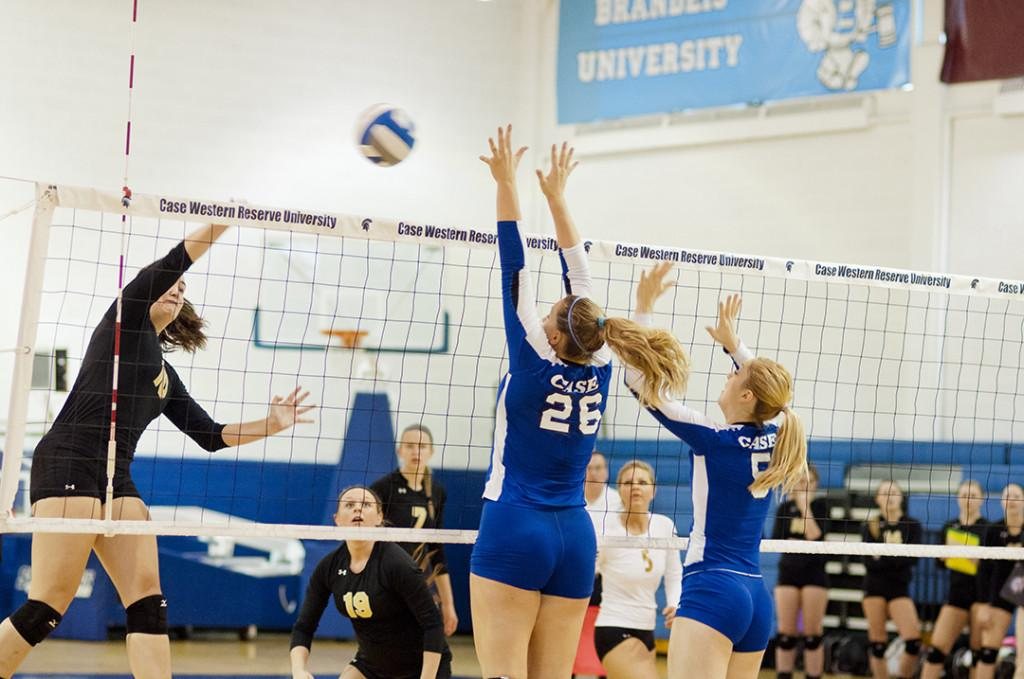 Natalie Southard and Carolyn Bogart defend the net during final home match against Wooster Nov. 2nd.