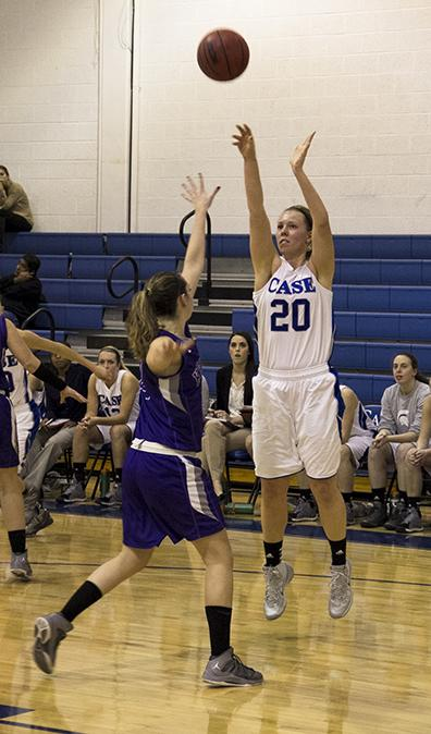 Spartan Erin Reynolds takes a shot during the home opening game versus Kenyon College.