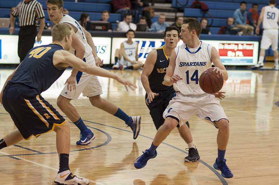 Sophomore Jimmy Holman goes to work against the Rochester defense at home last weekend.