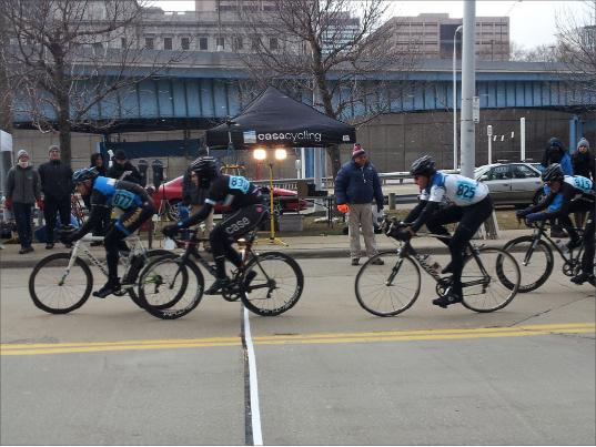 Cyclists pass checkpoint during downtown criterium.