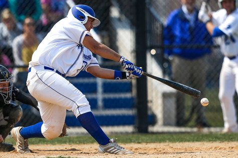 Spartan third baseman Andrew Gronski connects with a pitch during a game last season.