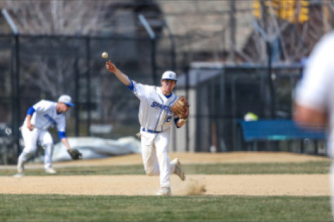 Third baseman Andrew Gronski connects with a pitch in a game at home last season.