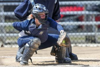 Spartan catcher Amy Taylor awaits pitch during a game last season.