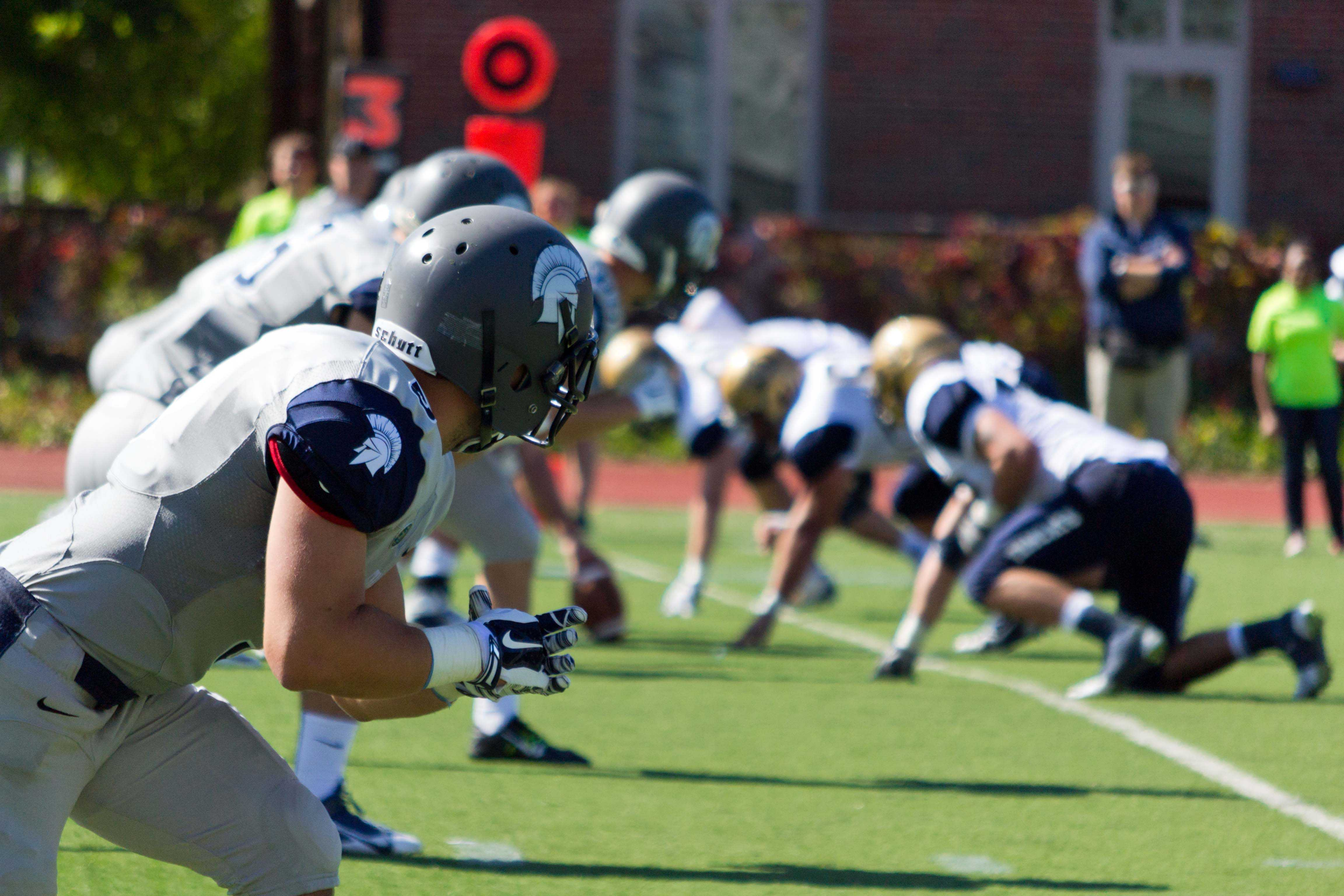 Spartan wide receivers wait for snap during last weekend's 23-16 victory over Thiel College.