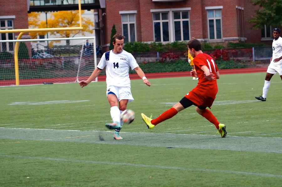 Ryan Meyer clears ball from the back line