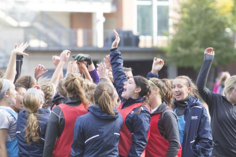 Women's soccer team cheers at start of overtime against New York University.