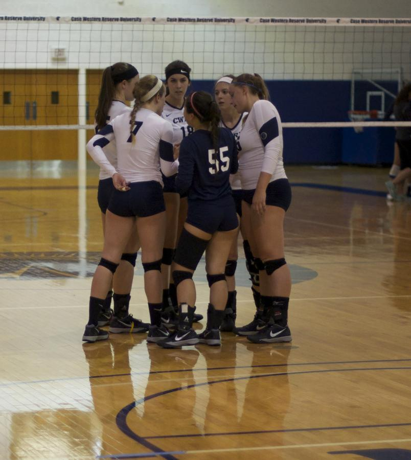 The CWRU volleyball squad huddles prior to the start of a new set. The team   finished their season over the weekend with a fifth place finish in the UAA.