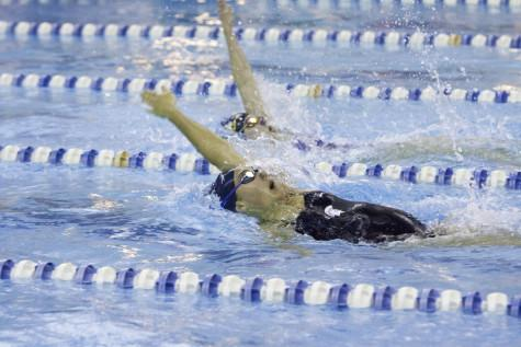 Spartan and Allegheny swimmers race to the wall in meet last weekend.