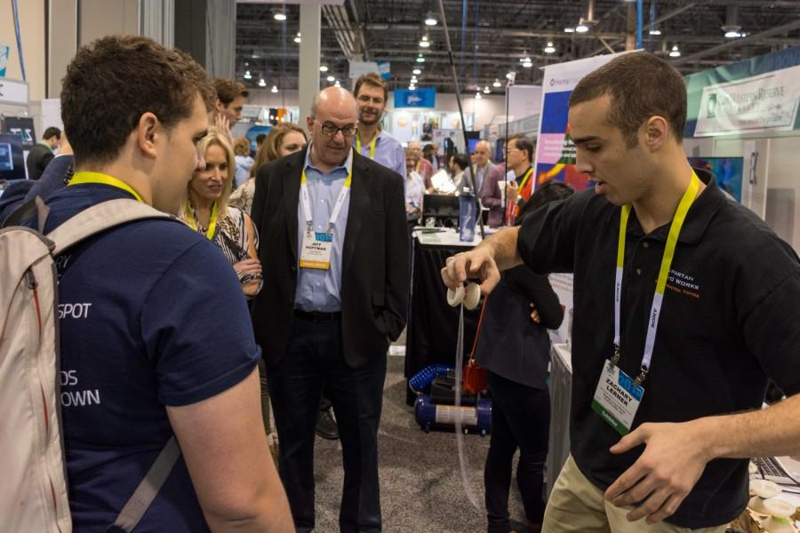 Zach Lerner brings in booth visitors with yoyo tricks and product demos.