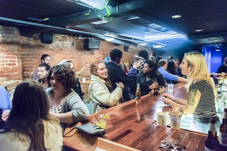 The small basement of the Euclid Tavern was busier than ever at