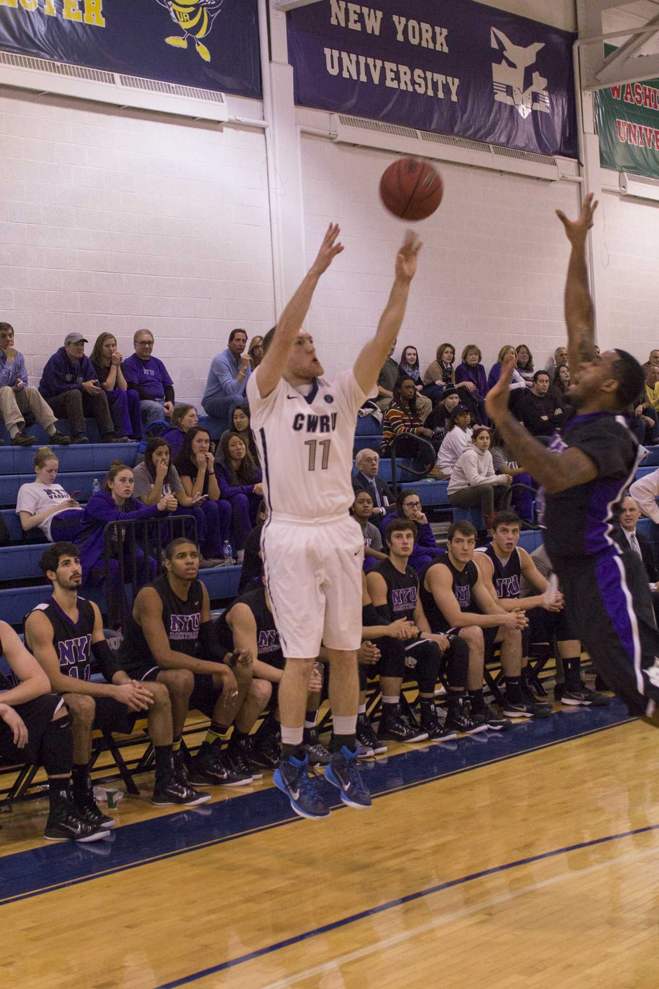 Junior Matt Clark hits a clutch three point shot against New York University.