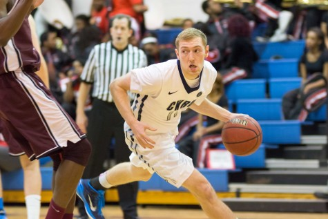 Junior Matt Clark tries to find the open man in the Spartan's loss against the University of Chicago Maroons.