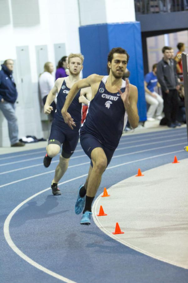 Spartan runners round the turn in the Veale Center during the Battle of the Obelisk meet against Carnegie Mellon University