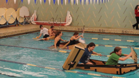 "In heat one, the ""USSC"" dashes from the wall to victory, while the ""Whale Wagon"" and ""1-2-1 Fierceness"" attempt to catch up in the inaugural Recycle Regatta in Donnell Pool."