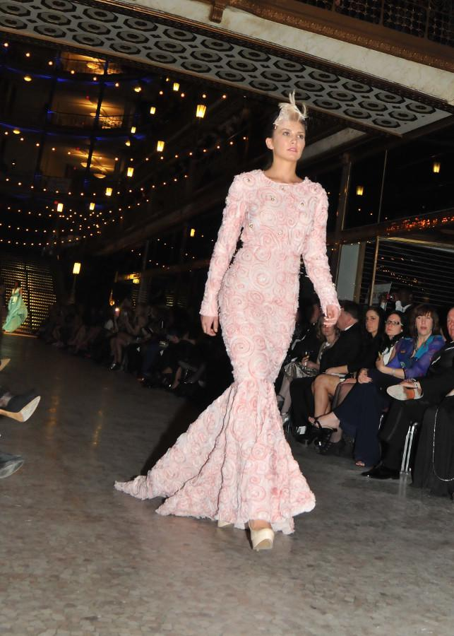 At Cleveland Fashion Week's runway shows, DeAndre Crenshaw's pink dresses emphasized femininity, whereas Althea Harper's blue dress showed off free spiritedness.