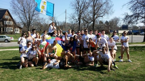 Runners pose for a picture after last year's Nearly Naked Mile, many sporting ZBT t-shirts.