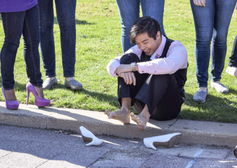 """One participant in Sigma Psi and Alpha Chi Omega's Walk a Mile in Her Shoes event found that """"her shoes"""" were less than comfortable."""