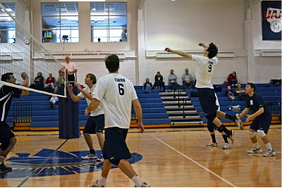 Men's Volleyball players compete earlier this season.