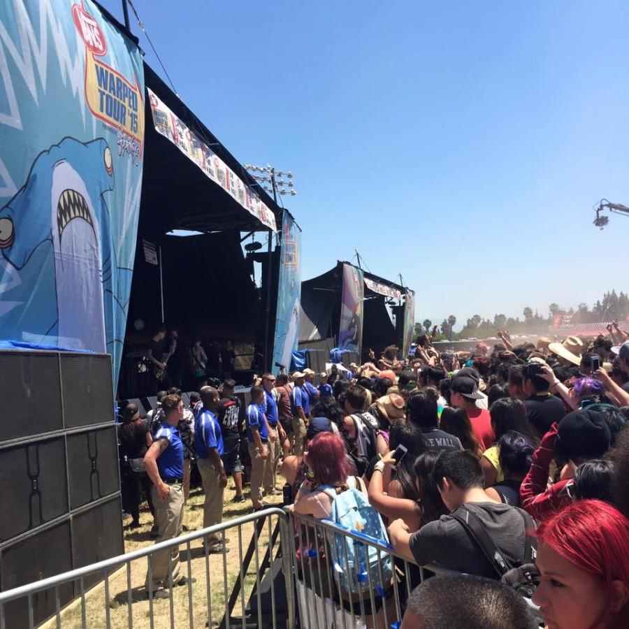 A crowd gathers at Warped Tour band Beartooth's stage; Beartooth is among the bands playing at Cleveland's stop of the nationwide tour.