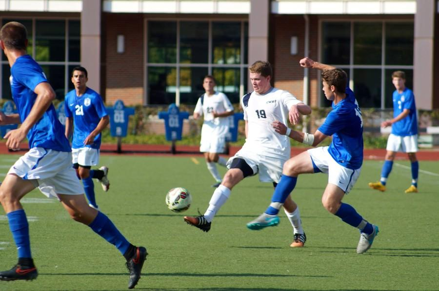 Midfielder Paul Darmstadter clears the ball up field against Thomas More. The Spartans split their first home series but rebounded this week against Baldwin Wallace.