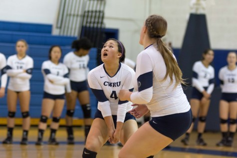 The volleyball team scrambles for a ball against Baldwin Wallace. The Spartans dropped their first game of the season in a nail biter Wednesday night.