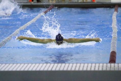 Spartan swimming speeds to win against John Carroll