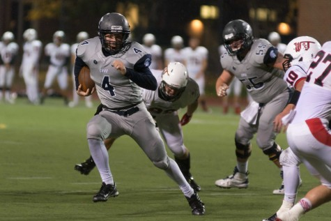 Quarterback Rob Cuda rushes out of the pocket during Friday's win over W&J. Cuda led the Spartans to their sixth straight win and will look to continue the streak this week at home.