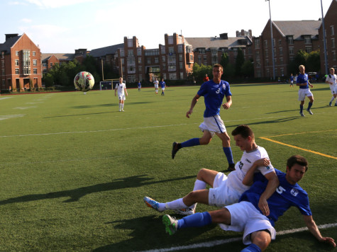Third year student Brandon White collides with a Thomas More defender earlier this season. The Spartans won their first UAA game this weekend against NYU.