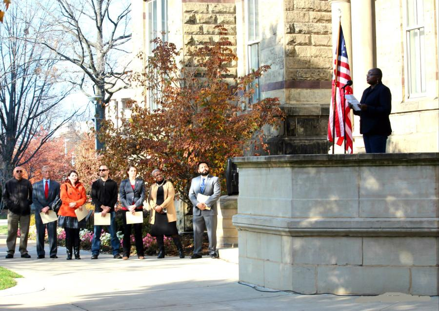 Readers+going+through+a+list+of+Ohio+veterans+killed+in+combat+paused+at+2+p.m.+so+that+the+gathered+crowd+could+take+part+in+a+national+minute+of+silence.