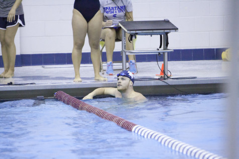 A Spartan swimmer looks up to see the race results. The results have been good as the Spartans continue to win on the road.