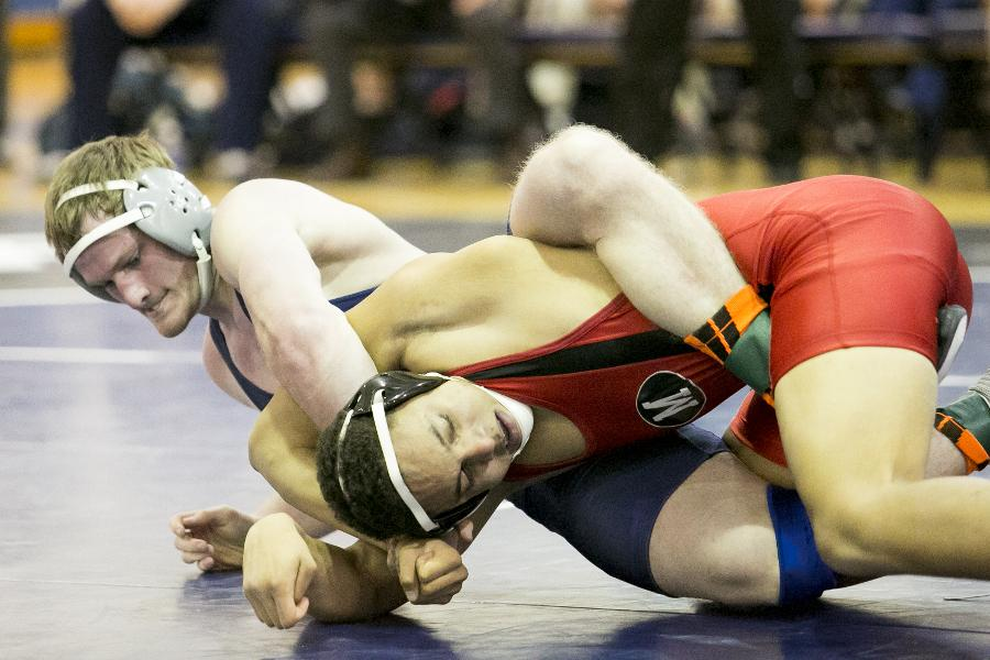 Nick Lees pins his opponent this weekend during the Si Ostrach Meet. Lees earned UAA Wrestler of the week in the Spartans first win of season.