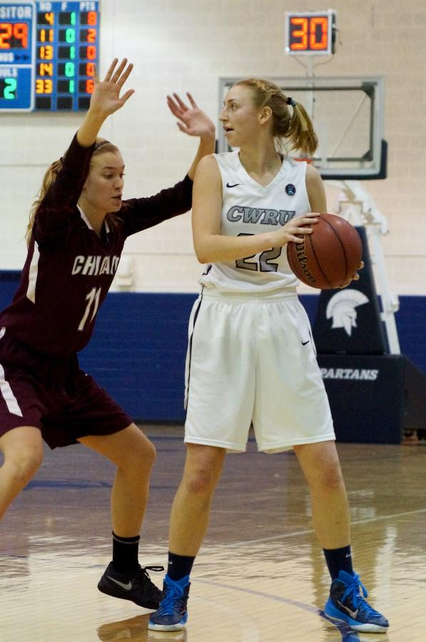 Jessica McCoy keeps the ball away from a University of Chicago defender this past weekend.