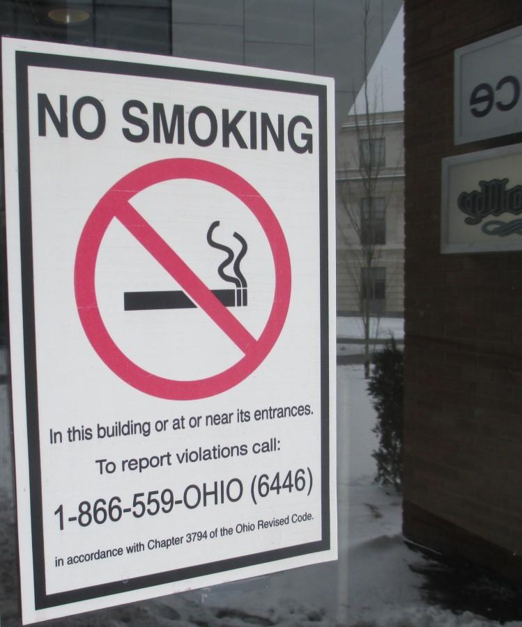 Smoking is prohibited in buildings on campus, a policy that may soon extend outside too.