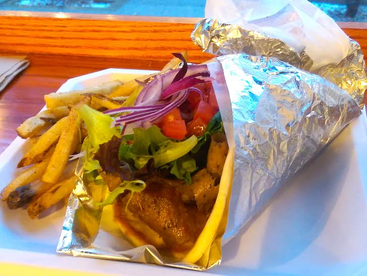 The restaurant offers large portions of delicious food like the Classic Gyro, which is topped with house-made Tzatziki sauce.