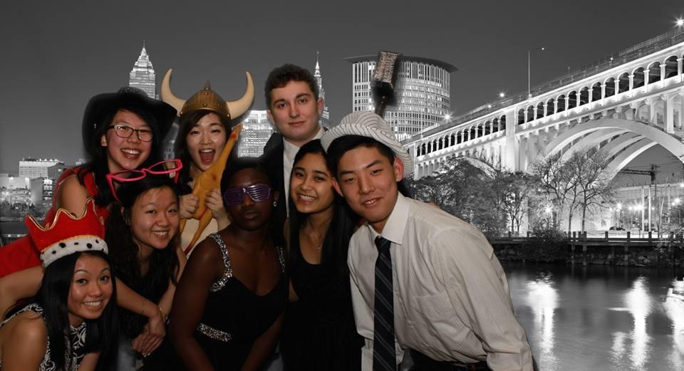 Students pose with props in the Snowball photo booth, one of the attractions at the annual dance downtown.