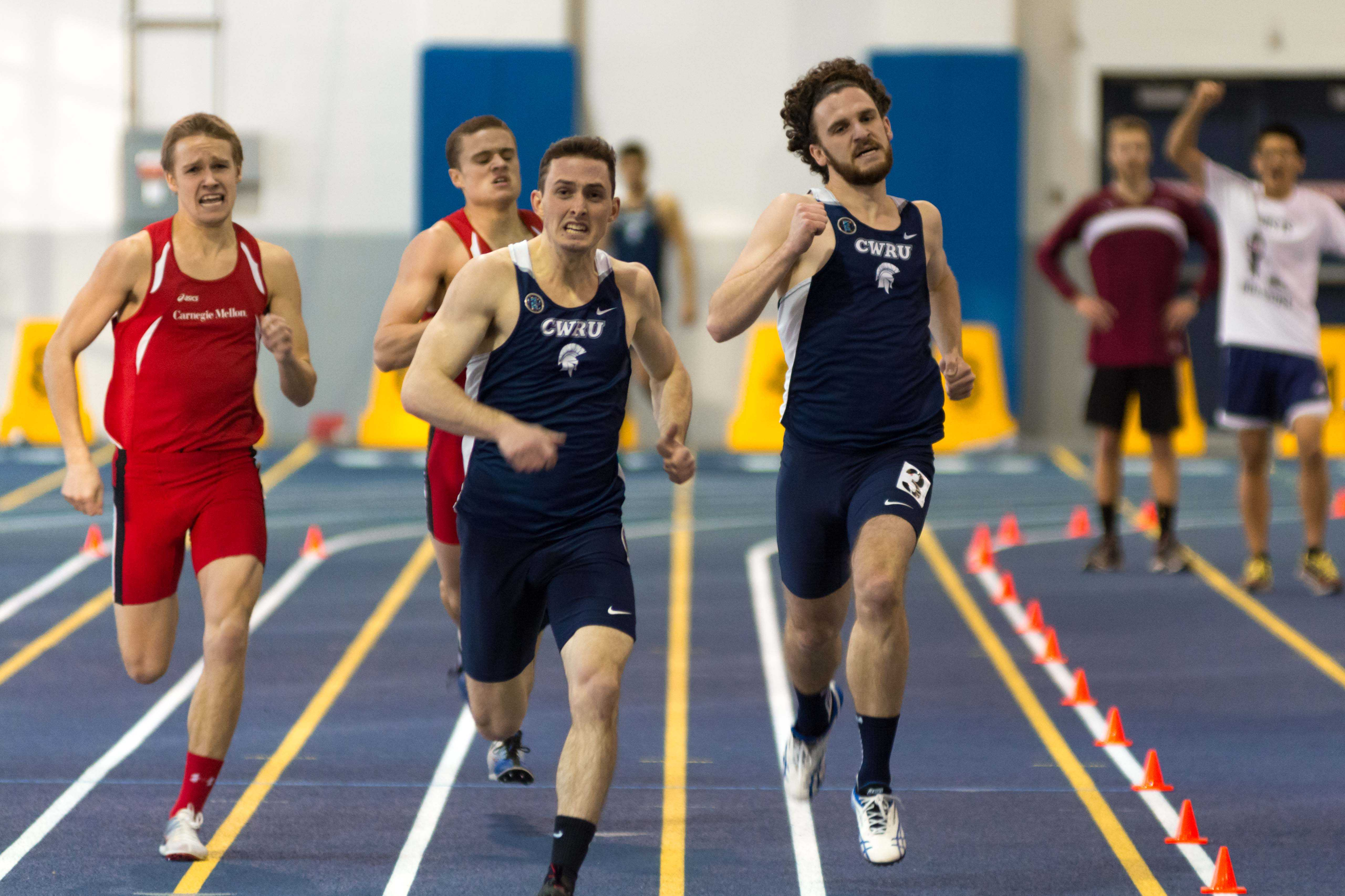 The Spartans sprint for first in Veale against archrival Carnegie Mellon.