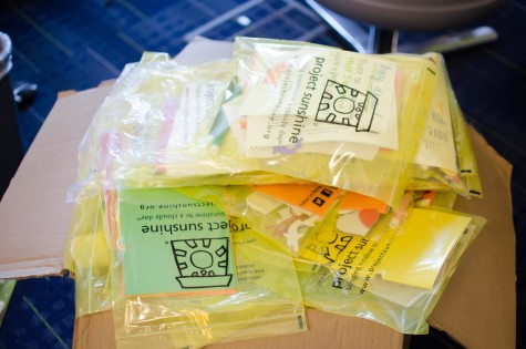 Volunteers at the Spreading Sunshine event exceeded their goal of putting together 300 kits to send to sick children.