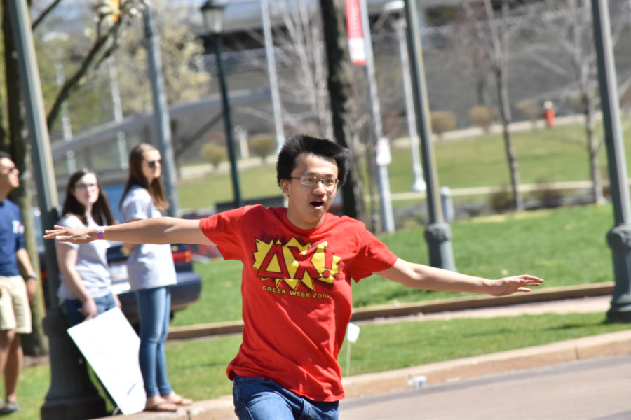 A student from Delta Chi tries to work in high heels