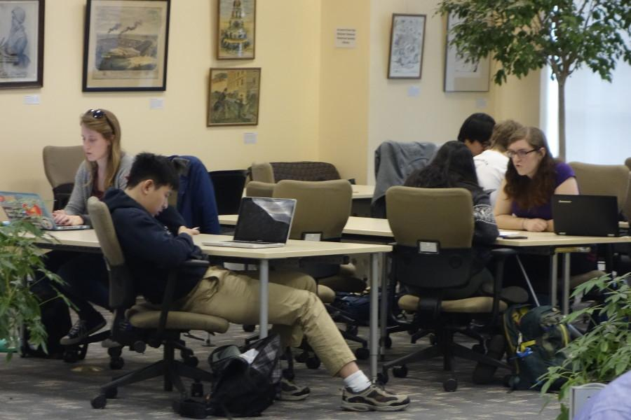Students studying in Kelvin Smith Library. To succeed, take care of yourself.