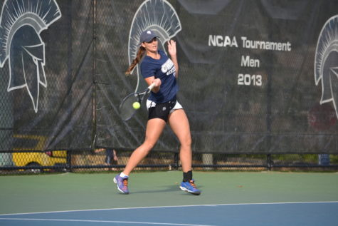 Sara Zargham returns a serve earlier this year. This Sunday, she clinched the upset win over the University of Chicago with a victory in the final singles match.