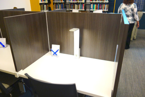 A cubicle in the newly renovated Lillian F. & Milford J. Harris Library in the Mandel School of Social Sciences. Graduate students often have more work near the semester's end.